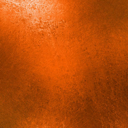 orange background with black vintage grunge texture and white corner highlight for thanksgiving or halloween backgrounds or fall and autumn seasonal backdrops photo