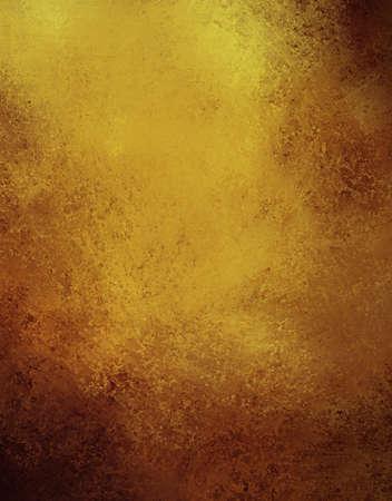 fondo de oro con un diseño abstracto de color marrón y negro en la frontera de cosecha, textura, fondo del grunge, de papel marrón de oro para los anuncios del aniversario de oro o invitaciones de la boda de fondo