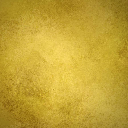 gold background or old gold paper with warm rich yellow and brown colors with vintage grunge background texture like gold wall wallpaper or plaster cement for weddings invitations or anniversary Stock Photo - 13544313