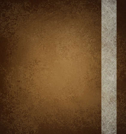 brown: brown background with vintage grunge background texture and ribbon stripe design of white parchment paper on brown wallpaper with blank copy space and highlight for ad or brochure Stock Photo