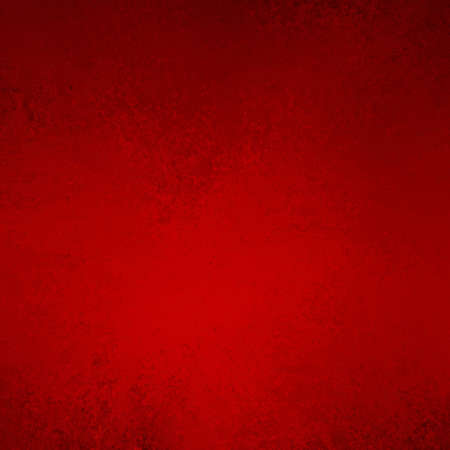 solid color: elegant red background with abstract vintage grunge background texture and soft center lighting on border of frame for Christmas holiday background or valentine