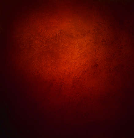 solid background: abstract orange red background, old black vignette border or frame, vintage grunge background texture design, warm red color tone for Christmas season, for brochures, paper or wallpaper, red wall Stock Photo