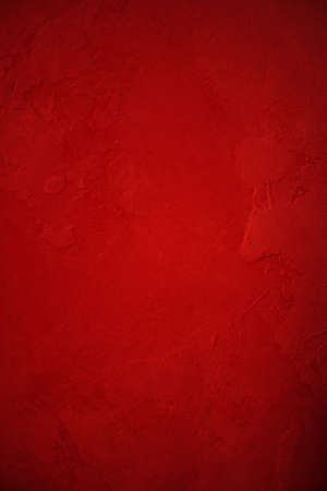 abstract red background painted plaster wall with deep vintage grunge background texture layout design for holiday Christmas background or brochure ad or web template background color