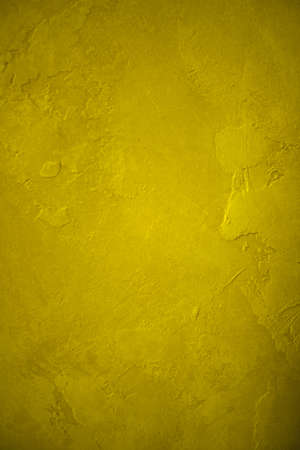 abstract yellow background plaster wall with rough deep vintage grunge background texture design and bright gold color for colorful brochure book cover or elegant old web template background design Stock Photo - 15139314
