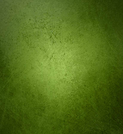 green wall: abstract green background aged design with vintage grunge background texture layout, old Christmas background paper, distressed sponge design in green colors for brochure ad poster or website backdrop Stock Photo