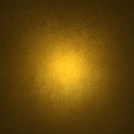 abstract yellow background black vignette frame on border of vintage grunge background texture with old faded edges and center spotlight for elegant gold Christmas background or web template backdrop Stock Photo - 19412684