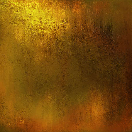 grunge gold background design layout, abstract yellow background warm brown color tone with vintage grunge background texture, earth or earthy background, gold luxury patina or bronze or brass colors Stock Photo