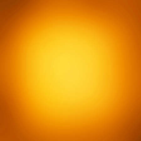 bright center: yellow orange background gold bright center texture smooth background gradient warm autumn colors background halloween Thanksgiving holiday backdrop, orange gold paper brochure web template background Stock Photo