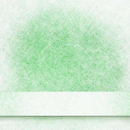 abstract green background frosty white border and white ribbon, cold winter background Christmas card or brochure, soft fuzzy white frost background with green center, scrapbook or website background photo
