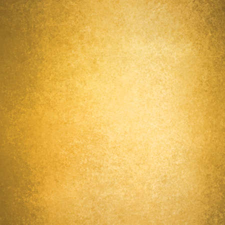 abstract gold background warm yellow color tone, vintage background texture faint grunge sponge design border, yellow paper photo