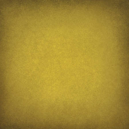 solid color: abstract yellow background, soft gold color image for use in brochure ads or web design backgrounds, faint vintage grunge background texture and darker border with light blank center for text  Stock Photo