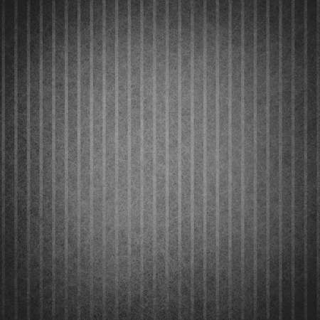 abstract black background or gray design pattern of vertical lines on faint vintage pattern of vintage grunge background texture on black border or monochrome card brochure or web template background  photo