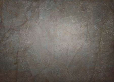 old vintage black background paper with crinkled worn border and faded white center light