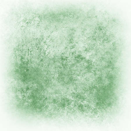 abstract white background, green distressed old vintage grunge background texture, faded white edged border,  photo