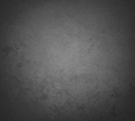 abstract black background with rough distressed aged texture photo