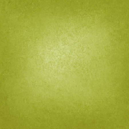 solid yellow green background with light center and darker border, faint detailed sponged vintage grunge background texture design, classy green display or presentation background, green web backdrop  photo