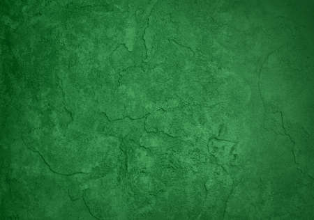 abstract green background, old black border or frame, vintage grunge background texture design, warm green color tone for Christmas or holiday, for brochures, paper or wallpaper, green wal photo