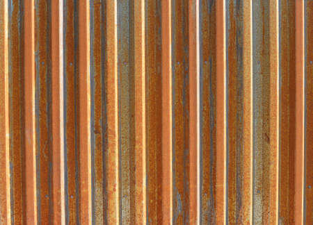 old weathered tin metal background with red orange rust and corrugated metal texture grunge design  photo