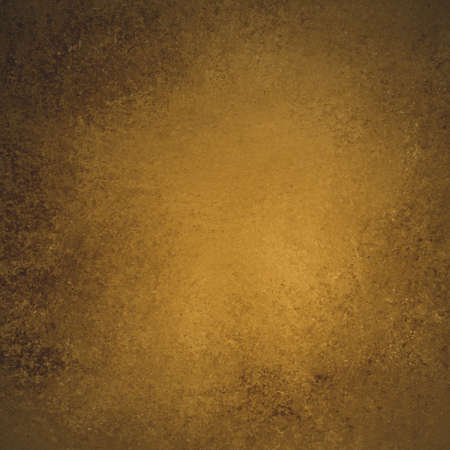 rustic brown gold grunge background with darker brown grungy border and vintage texture design photo