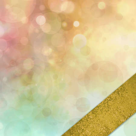 dreamy: abstract colorful background, blurred bokeh lights on multicolored backdrop, floating round circle shapes or bubbles with angled gold ribbon in corner border Stock Photo