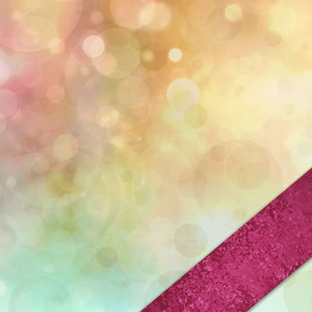 abstract colorful background, blurred bokeh lights on multicolored backdrop, floating round circle shapes or bubbles with angled pink ribbon in corner border photo