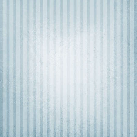 faded vintage blue and white striped background, shabby chic line design element on distressed texture with white center spot Stock Photo