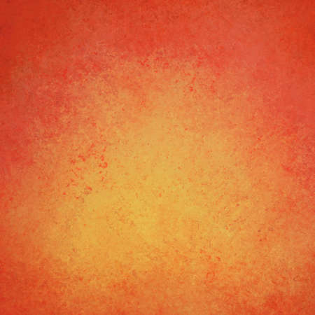 abstract warm background orange yellow color center dark frame, soft faded sponge vintage grunge background texture design, graphic art for product design web template, warm orange gold background  photo