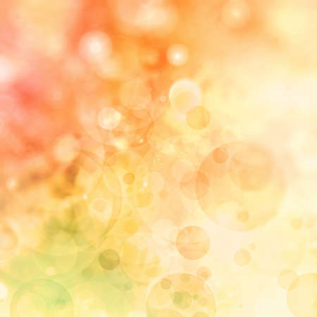 orange color: abstract colorful background, blurred bokeh lights on multicolored backdrop, floating round circle shapes or bubbles Stock Photo