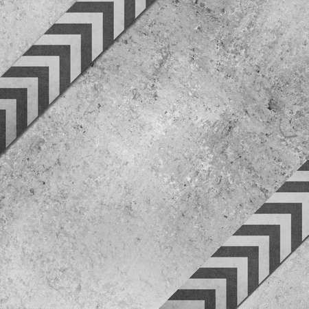 gray background paper with angled chevron striped ribbon pattern design with vintage grunge texture photo