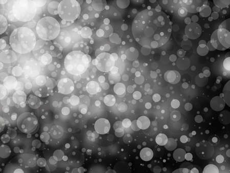gray black and white bokeh background. Shimmering white Christmas lights or abstract falling snow. Festive party background. Fantasy night or magical background glitter sparkles