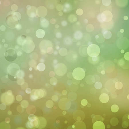 Beautiful green gold bokeh background with shimmering colors and white lights Festive party background. Fantasy night or magical glitter background sparkles photo