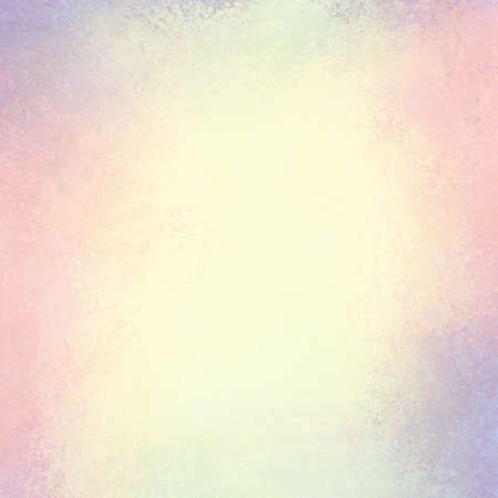 soft yellowed pink and blue background with faded white center and pastel color border, vintage background grunge texture design 写真素材