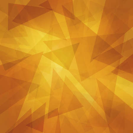 triangle pattern background with random abstract background design and texture, yellow orange gold and brown triangles layered on yellow background photo