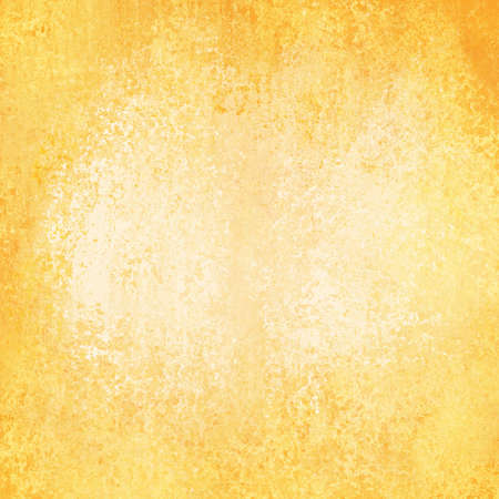 faded gold background with vintage grunge background texture design, old gold paper, distressed worn texture 免版税图像