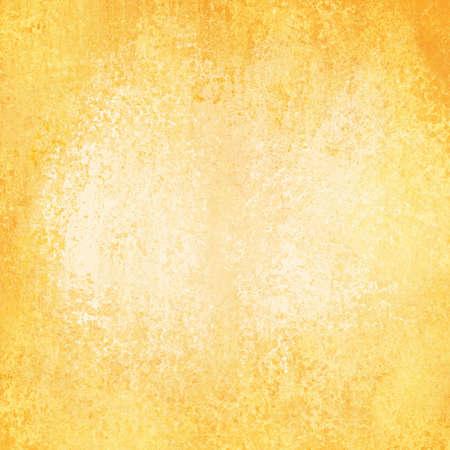 faded gold background with vintage grunge background texture design, old gold paper, distressed worn texture Standard-Bild