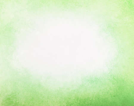 abstract faded spring green background, gradient white into light yellow green color, foggy white center and darker green grunge texture border