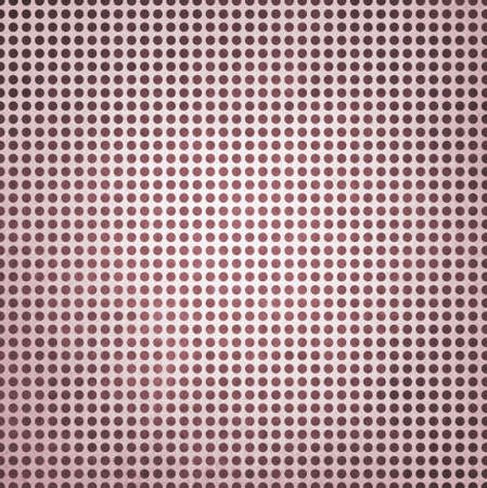 vintage polka dotted burgundy red background, burgundy spots on white paper with faint white center spot lighting photo