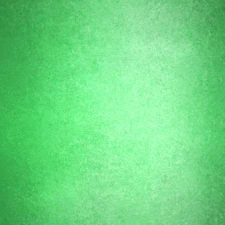 distressed paper: solid green background, Christmas color background with dark black edges and vintage grunge background texture, distressed old style design dark green paper, background image for web or brochure Stock Photo