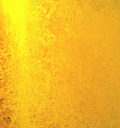 smeary: abstract gold background, fiery yellow and orange colors with sponge vintage grunge background texture, distressed rough smeary paint on wall, art canvas or board for brochure ad or website template Stock Photo