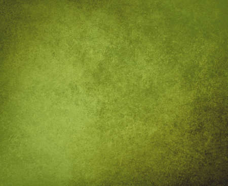 green background or grunge texture in olive green color, with black vintage grunge frame, has old faded solid background for text or copy space