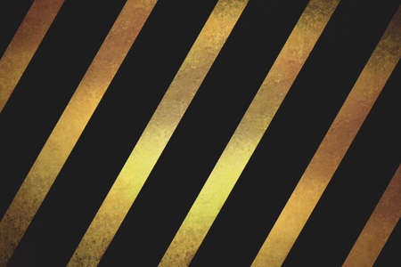 gold textured background: shiny gold textured ribbon slanted diagonally in striped pattern on black background