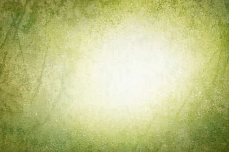 copyspace: green vintage background texture with blurred white center copyspace