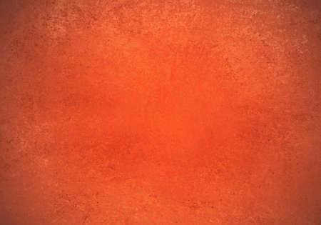 papel quemado: fondo de color naranja de halloween con la textura de la vendimia Foto de archivo