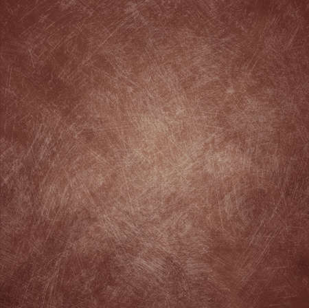 brown: abstract blurred geometric pattern dark brown background with shabby distressed vintage background texture and soft center lighting for text