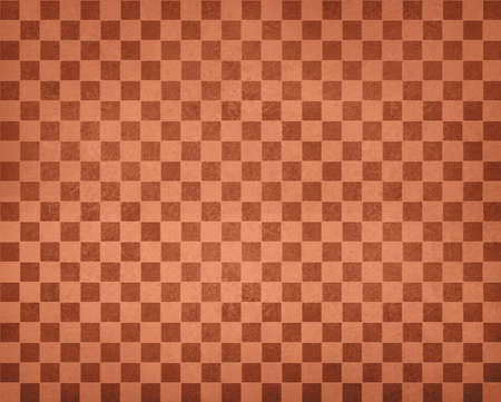 halloween pattern: vintage checkered background pattern, rows of brown orange squares of vintage texture, orange checked wallpaper design, shabby chic country style, autumn background, halloween or thanksgiving color Stock Photo