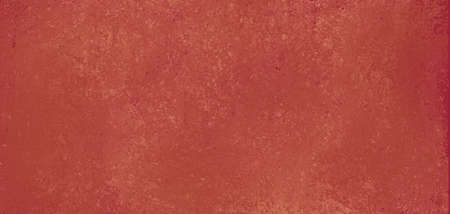 dull orange red painted wall, vintage plaster or cement style rough distressed texture Imagens