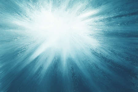 star or starburst background in bright white on blue sky, shining star at night or blurred sun in sky concept
