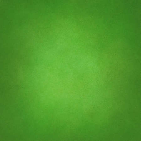 elegant green background with light center and light distressed vintage background texture Standard-Bild