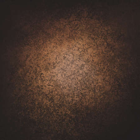 sponged: warm dark brown coffee color background with orange center lighting Stock Photo