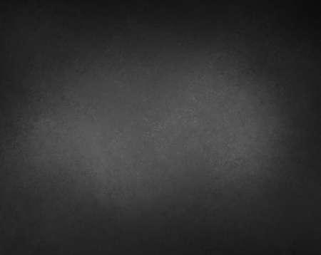 Zwarte achtergrond met grijze centrum lichtvlek en vignet grens met textuur